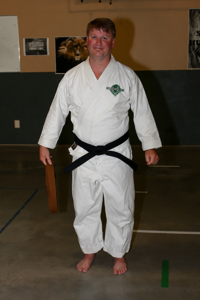 Rob Schroeder receiving his Shodan black belt 2